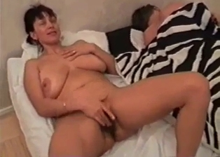 Real mom gives me a very good blowjob in the bedroom