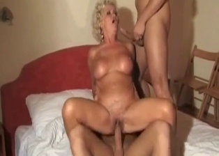 Fake-boobed mature and her perverted young sons