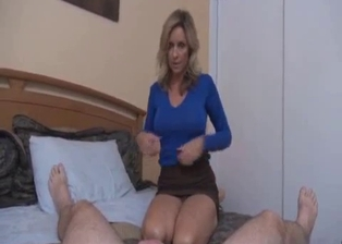 Big-boobed MILF sucks a big cock of her own son